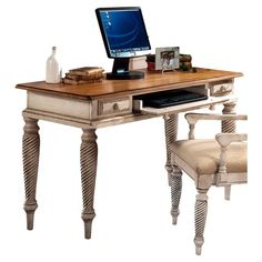 Pen thank-you notes or write out meal plans at this 2-drawer distressed wood desk, featuring an English dovetail-inspired design and a roll-out keyboard tray.