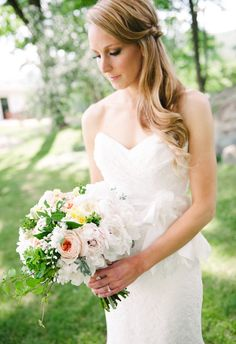Perfectly curled tendrils, romantic half up-do, elegant bridal hair // Ron Dressel Photography