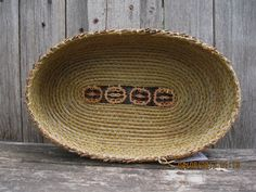 Coiled Pine Needle Basket - Large oval with 4 walnut slices in bottom. $195.00, via Etsy.