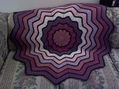 Pretty progression and stained glass look with the black. Do with every other row in back loop only to be even more striking! Ravelry: Lyn's Round Ripple Baby Afghan pattern by Lyn's Designs