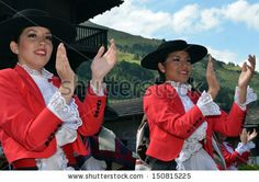 Beautiful Chilean dancers clapping at the International Festival of Folklore and Dance from the mountains  2013 in Evolene Switzerland - stock photo
