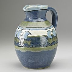 "FANNIE LEVINE; SATURDAY EVENING GIRLS;  Rare and early pitcher decorated with Viking ships in cuerda seca on blue and green ground, Boston, MA, 1909; Signed with bowl shop mark, SEG/FL 180-5-09; 9"" x 7"""