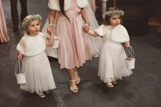 Flower Girls with gypsophila baby's breath flower crowns - Image by Christopher Currie Photography - An Essense of Australia wedding dress for a Winter wedding at Kinkell Byre in Scotland with a pastel rose bouquet photographed by Christopher Currie.