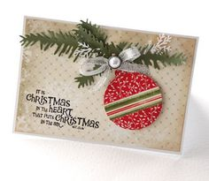 Love this card.  Wonder where the stamped message comes from and the die to cut the pine branches.