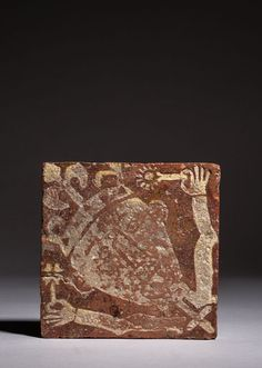 A King holding flowers 12.6 x 12.6 cm; red earthenware tile decorated with white inlay C13-C14th Warwickshire, Sam Fogg Gallery