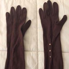 Vintage long brown gloves Beautiful and classic vintage long brown gloves. Buttons in tact on both gloves. Perfect to stay warm this winter! These seem small, no tag to corroborated!  **Bundle to save! Price accommodates shipping and fees!** Accessories Gloves & Mittens
