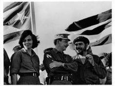 Vilma Espín, Raúl Castro y Che Guevara. En la tribuna, Santiago de Cuba. Foto: Rodrigo Moya