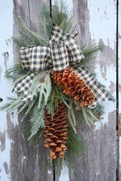 DIY door swag with large pinecones and black and white check gingham buffalo plaid ribbon. Such a sweet and easy Christmas decor DIY idea!