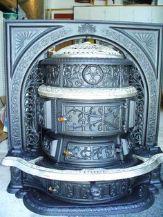 Another great parlor stove..this one with a fancy surround.