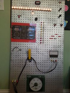 """VBS 2014 Agency D3 """"Control Panel"""" for room decorations~super easy...$7 peg board, silver spray paint, junk from the garage and around the house, clip art from the computer, leftover fall twinkle lights, and a hot glue gun."""