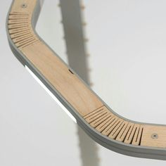 flexible wood constrained to a form