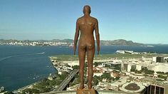 """Antony Gormley's rooftop statues 'scare' passers-by in Rio - British artist Antony Gormley has placed 31 life-sized replicas of himself gazing off the edges of rooftops in downtown Rio de Janeiro prompting numerous calls to the police. The Brazilian media has dubbed them """"suicidal statues"""" but the sculptor says they have had the affect he wanted: to make people who live in the city stop and think about human kind's place in nature."""