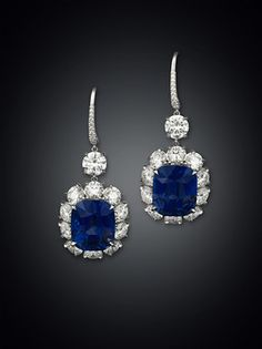 Two exceptional Ceylon sapphires glow amid sparkling diamonds in this stunning pair of drop earrings ~ M.S. Rau Antiques