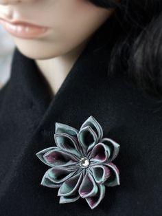 Delicate lustrous brooch flower