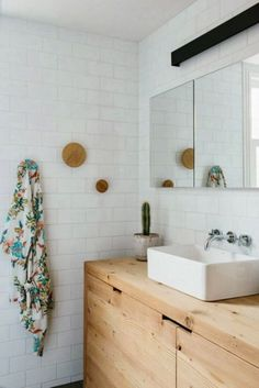 wood vanity with subway tiles