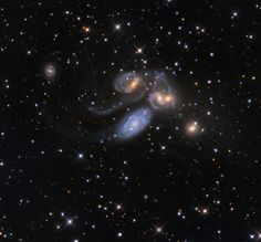 This grouping of five galaxies 280 million light-years away in the constellation Pegasus is known as Stephan's Quintet. Four of the five galaxies are experiencing a violent merger, where they crash into one another an eventually form one galaxy. Though it looks like the central blue galaxy is part of this clan, this is an illusion. It is actually a foreground galaxy only about 40 million light-years away.  Image: Adam Block and Vic Eden/Mount Lemmon SkyCenter/University of Arizona