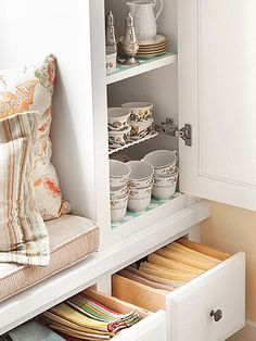 Drawers under kitchen window seat - great idea for usable storage under a window seat.
