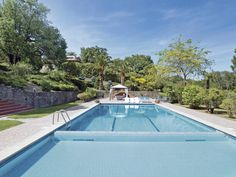 Enjoy the private swimming pool and large garden at this property, where you can take advantage of the lake views.