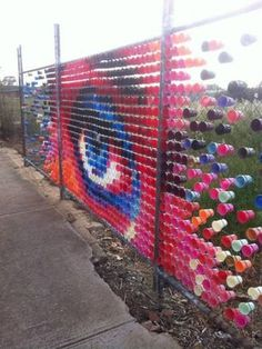 Awesome public art installation from coloured cups in a fence, we could all try this ! East st Brompton Adelaide Australia Looked great from the train Hyde & Seek : Art Public, Instalation Art, Urbane Kunst, Fence Art, Collaborative Art, Wow Art, Recycled Art, Outdoor Art, Land Art