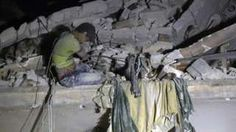 Image copyright                  AFP                  Image caption                                      Rescuers used a crane to reach this 12-year-old boy who was trapped in rubble                                Fourteen members of one family have died in an air strike on rebel-held east Aleppo, volunteer rescuers say. Eight children and two women were among t