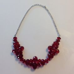 "Raspberry Acrylic and Silver Necklace Silver toned chain. Approx. 26"" Slips over your head. Jewelry Necklaces"