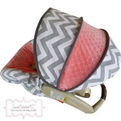 Great idea! Slip cover for the car seat so that you can change the look without buying a new carseat. I like this coral and gray carseat cover.