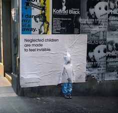 """This provoking street campaign for the Australian Childhood Foundation can be seen right now in Melbourne. For their ongoing campaign """"Stop Child Abuse Now"""", they used child size mannequins to represent children suffering neglect. The mannequins were placed in high traffic locations around the city and then a billposter was pasted over the top of the figure so only the feet and legs could be seen. Words on the poster read, """"Neglected Children are made to feel invisible."""""""