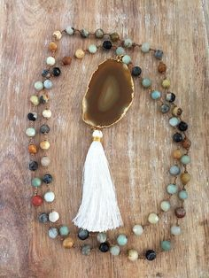 Hey, I found this really awesome Etsy listing at https://www.etsy.com/listing/237582299/brown-agate-slice-necklace-gold-white