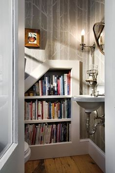 LOVE the idea of a built in bookshelf. Maybe for not often used books going down the basement steps. Ah, and for cookbooks!
