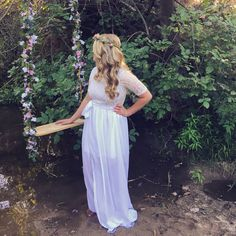 Secret garden photoshoot for engagement photos. Looks enchanted with the flower swing and flower crown.