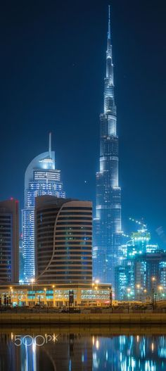 Burj Khalifa by Simone Castoldi . Burj Khalifa, known as Burj Dubai prior is… Amazing Buildings, Modern Buildings, Futuristic Architecture, Amazing Architecture, Abu Dhabi, Places To Travel, Places To See, Places Around The World, Around The Worlds