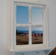 Framed Beach Photo Framed Photography Annapolis Photo Handmade Frame *Faux window frame was painted white, then distressed  *20 x 26 with a 4 shelf and 2 wood pegs underneath to possibly hold a dog leash or set of keys.  *Photo was taken of Chesapeake Bay in Annapolis, MD  All of our items are handmade in our shop, not mass produced https://www.etsy.com/shop/pineterracetreasures