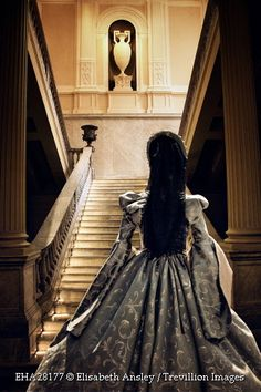 Trevillion Images - historical-woman-by-grand-staircase