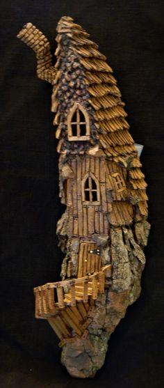 Cottonwood Bark carving by N. Minske - long walk up to the door. Door opens to reveal ladder going upstairs.