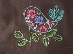 Made with a pattern from the HoopLove vintage embroidery transfers pool. Colors drawn from a pair of striped leggings I included with the gift.