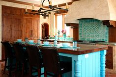 Lovely tile arrangement in a Mexican kitchen, by Jean Stoffer Designs.