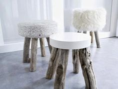 love the incongruity of the rustic wood legs with luxe seats in pristine white textures