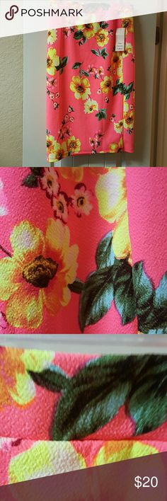 ♡Clearance♡Skirt by One Sweet Love Fabulous Skirt Hawaiian Motif//Stretchy // New with Tags//XL but wears like a Large//97% Polyester/3% Spandex//Perfect for the Summer//Great for a Beach trip or fun party outfit/ Beautiful Coral background wirh Lovely Yellow/Peach/Green Flowers and Leaves//Extremely Comfortable too! From waist down it's 27 inches long/Great on TALL LADIES TOO!  Wears like a Large although XL. One Sweet Love Skirts
