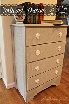 A plain dresser gets a makeover with paintable wallpaper, Annie Sloan Chalk Paint, and spray paint. girlinthegarage.net