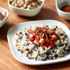 Koshari is flavorful combination of rice, lentils, and macaroni topped with a delicious tomato chile sauce, garbanzo beans and crispy fried onions.