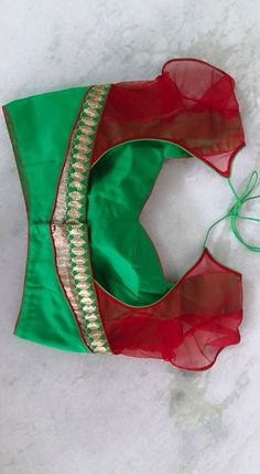 Interesting combination of green and red. Can be used with most of the bridal sarees..