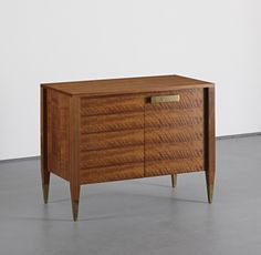 Gio Ponti; Walnut and Brass Cabinet for Singer & Sons, c1950.