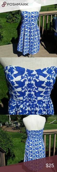 """Blue and white bird and floral motif dress NWT Blue and white bird and floral motif strapless a line dress. Love it, was given as a gift but sadly I grew horizontally before I could wear it. NWT measurement laying flat bust 18"""" (but can expand as there is elastic in back,) waist 14"""" hips free length 32"""" excellent condition as its never been worn much less tried on Old Navy Dresses Midi"""