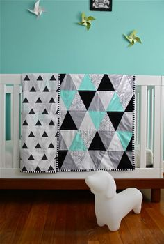 custom feather chevron triangle quilt, via Etsy.