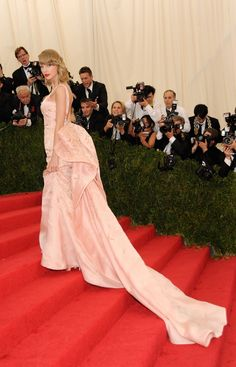 We hope she doesn't lose a glass slipper. Taylor Swift channels a pink Cinderella on the red carpet at the Costume Institute of the Metropolitan Museum of Art's Charles James: Beyond Fashion exhibit on May 5 in New York
