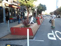 """This """"parklet"""" in San Francisco returns several automobile parking spaces back to pedestrian use by incorporating bicycle parking, benches, and plantings at sidewalk height. This is a temporary installation that city planners are testing in anticipation of a more permanent takeover. 