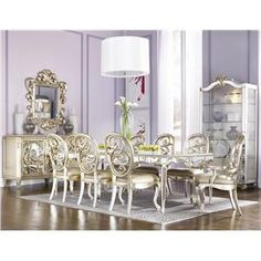 Whimsical Silver Leaf Mirrored Leg Dining Table- LOVE IT! Can you imagine how amazing this would look with holiday decorations and a beautiful centerpiece!?
