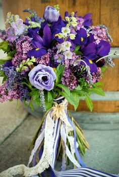 lilac, larkspur, iris, lisianthus, lavender, montecasino, stock, limonium, trachelium, and ranunculus, along with fresh mint and rosemary  reception wedding flowers,  wedding decor, wedding flower centerpiece, wedding flower arrangement, add pic source on comment and we will update it. www.myfloweraffair.com can create this beautiful wedding flower look.