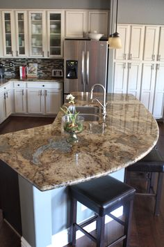 My kitchen with antiqued finished, cream cabinets and espresso island. #island #granite #kitchen