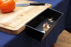 18 Magnet Projects to Get You Super Organized - Detachable Waste Container for Chopping Board